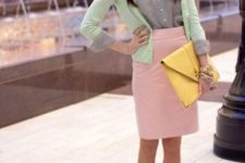 With shirt, pastel pink skirt and yellow clutch