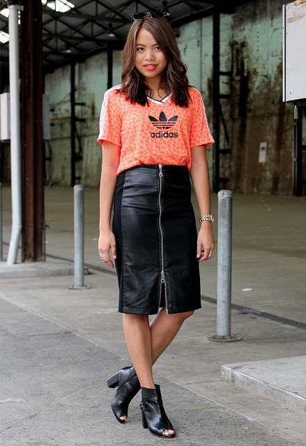 With sporty t-shirt and leather boots