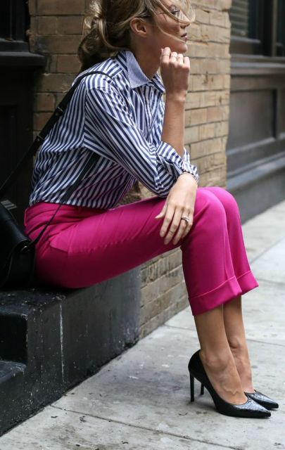 With striped button down shirt, black pumps and black small bag