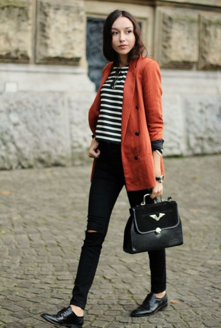 With striped crop shirt, black pants, boots and bag