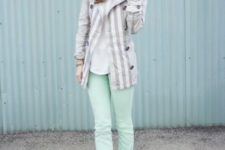 With striped jacket and black pumps
