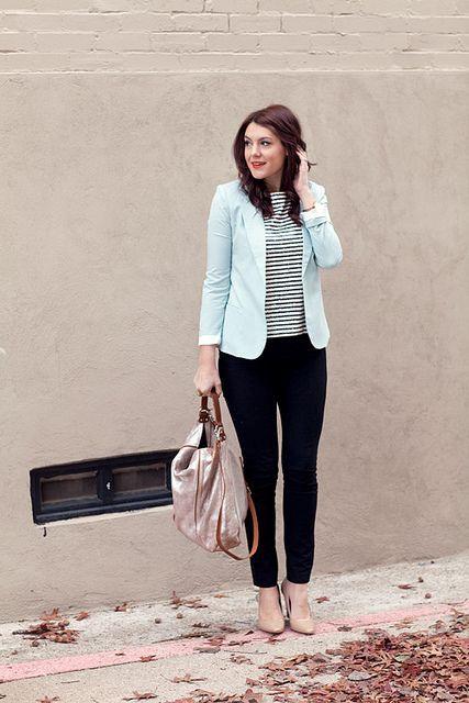 With striped shirt, black pants and big bag