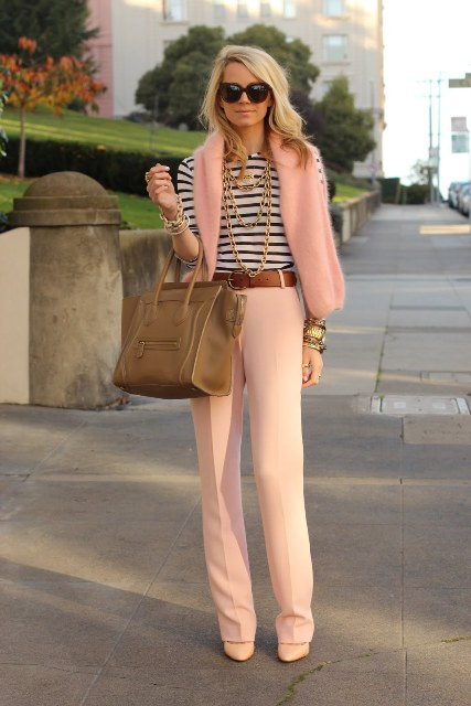 With striped shirt, brown belt, neutral shoes and big bag