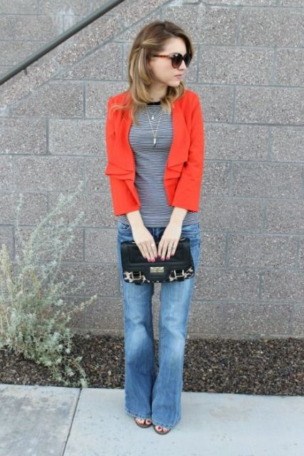 With striped shirt, flare jeans and clutch