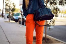 With striped shirt, heels and black bag