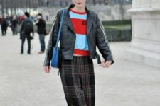 With striped shirt, leather jacket and blue bag