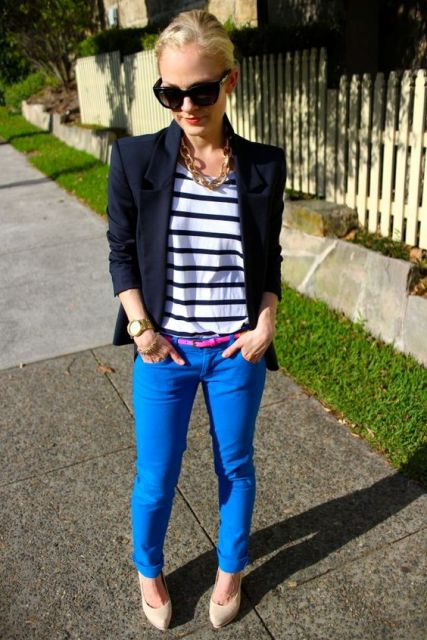 With striped shirt, navy blue jacket, neutral color shoes and sunglasses
