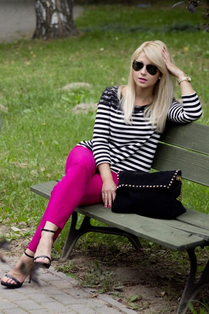 With striped shirt, sandals and suede bag