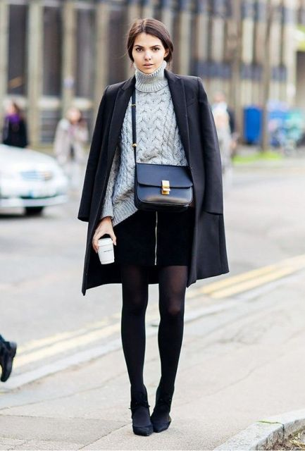 With turtleneck, black tights, heels and crossbody bag