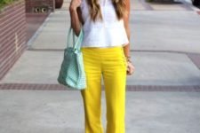 With white blouse and big pastel color bag