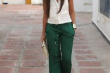 With white blouse and clutch