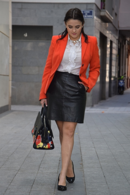 Picture Of With white blouse, leather skirt and flats