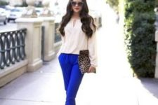 With white blouse, leopard clutch and metallic shoes