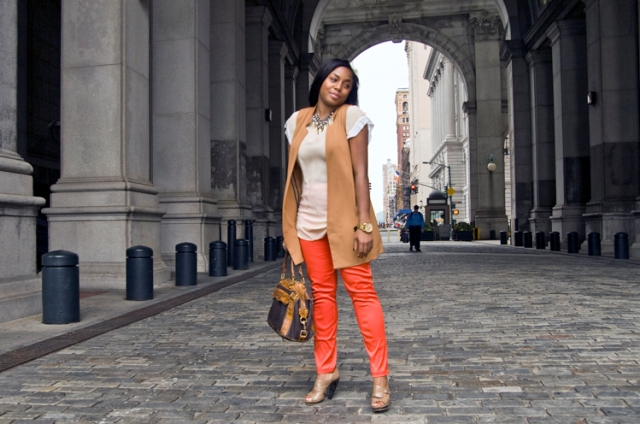 With white blouse, long vest and two color bag