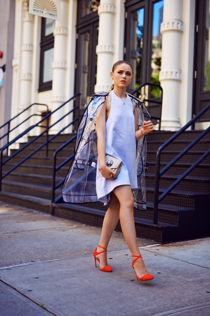 With white dress and clutch