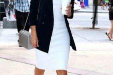 With white dress, black jacket and metallic bag