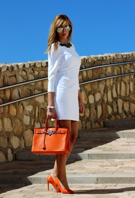 With white mini dress and leather bag