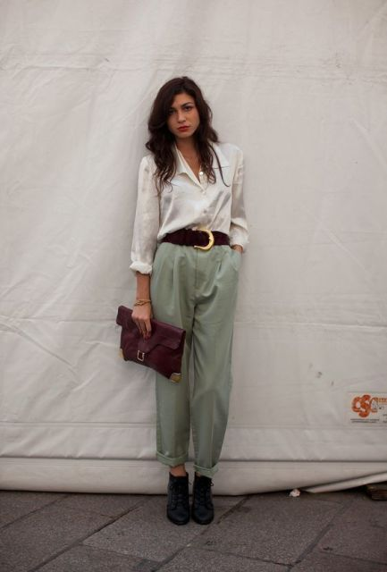 With white shirt, black ankle boots and marsala clutch