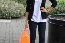 With white shirt, black jacket, jeans and orange bag