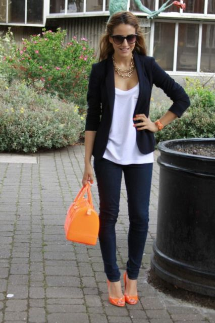 With white shirt, black jacket, jeans and orange bag