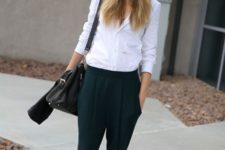With white shirt, cap and black mid calf boots