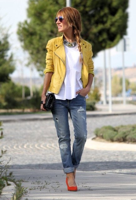 With white shirt, cuffed jeans, yellow jacket and clutch