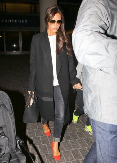 With white shirt, gray jeans and black coat