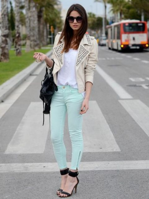 With white shirt, leather jacket and black heels