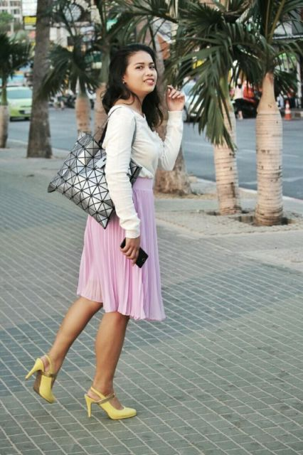 With white shirt, pale pink skirt and bag
