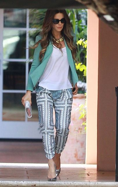 With white shirt, printed pants and metallic shoes