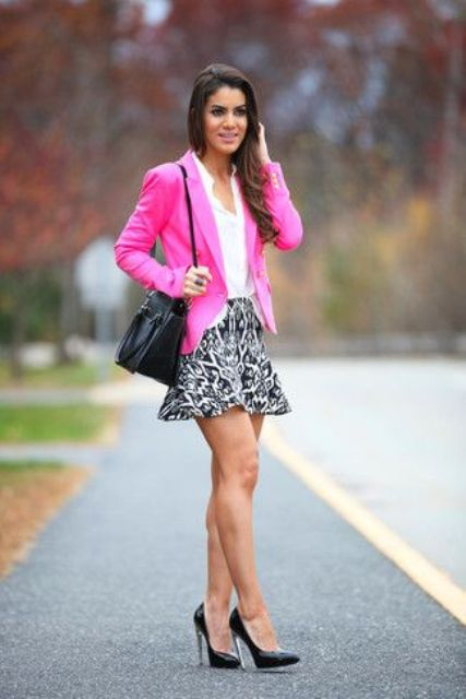 With white shirt, printed skirt and black pumps