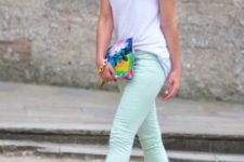 With white t-shirt, black pumps and watercolor clutch
