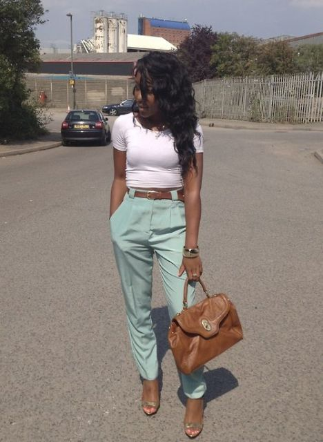 With white t-shirt, brown belt and bag