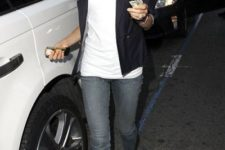With white t-shirt, gray jeans and black jacket