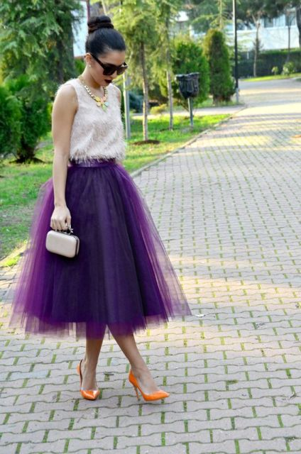 With white top, tulle skirt and mini bag