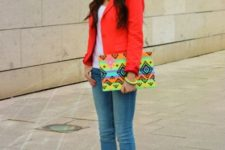 With white top,jeans and printed clutch