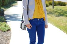 With yellow blouse, beige blazer, two color shoes and mini bag