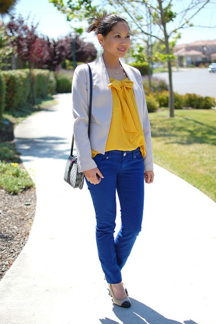 Picture Of With yellow blouse beige blazer two color shoes and mini bag