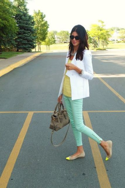 With yellow shirt, white blazer and yellow and beige flats