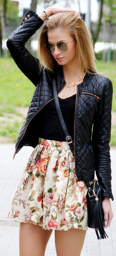 a black quilted moto jacket, a black top and a floral mini