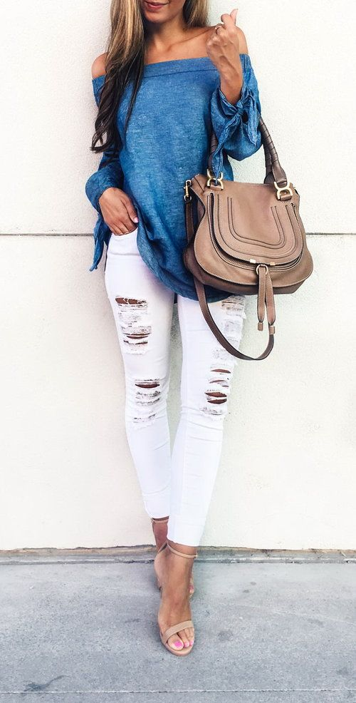 a blue off the shoulder top, ripped white denim, nude heels