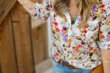 02 a bold floral blouse, ripped skinnies and a brown belt