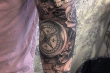 02 a map sleeve tattoo with roses, a wolf and a compass