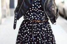 02 a navy and white polka dot dress with a brown belt and a black leather jacket