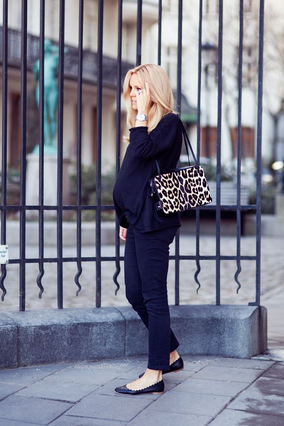 a navy suit, black flats and a leopard tote
