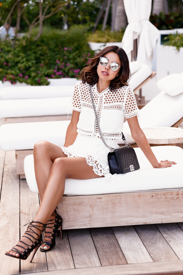 a white crochet lace mini dress and lace up sandals