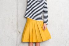 02 a yellow pleated midi, a striped shirt and light brown boots