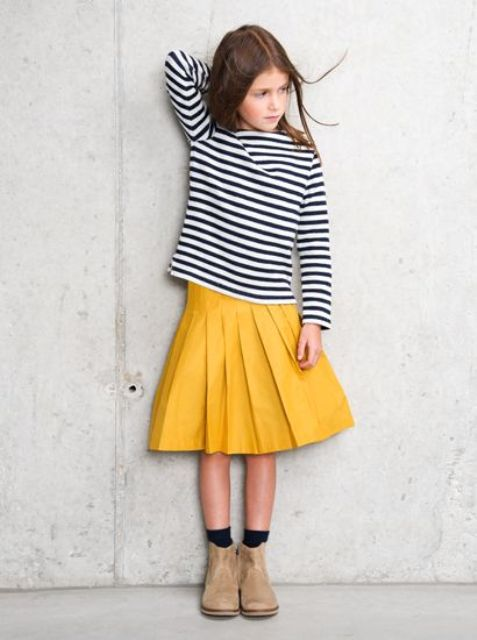 a yellow pleated midi, a striped shirt and light brown boots