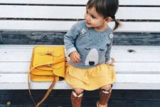 02 a yellow skirt and sandals, high socks and a grey sweatshirt with a bear