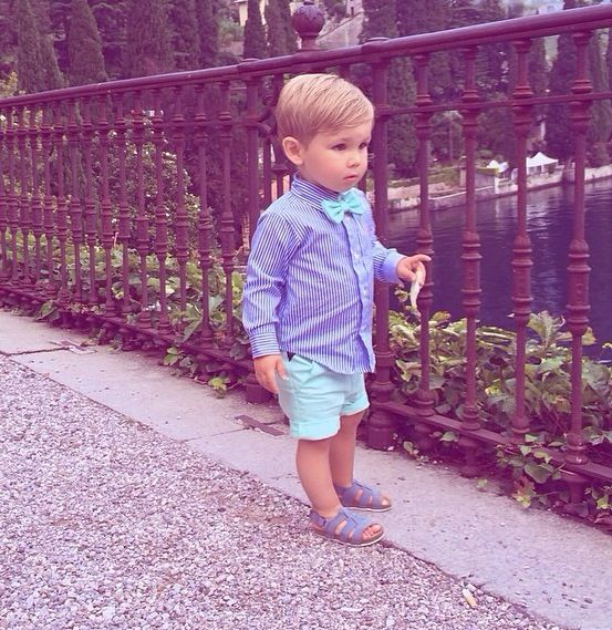 fancy little boy spring look with mint shorts and a bow tie, blue sandals and a striped blue shirt